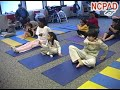 Photo of children with disabilities in a yoga class practicing eye exercises.