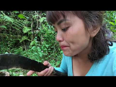 Primitive life - People in the forest lift a skirt to find fruit on ethnic girls