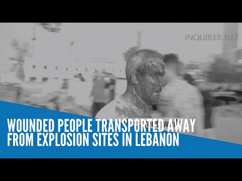 Wounded people transported away from explosion sites in Lebanon