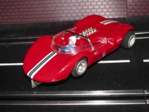 Red COX Lil Cucaracha slot car on Test Track