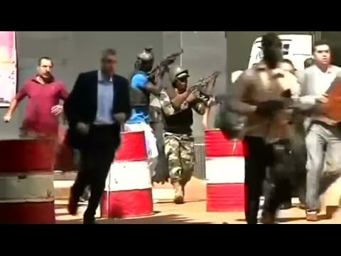 Video footage shows Malian security forces storming the Bamako hotel to end a siege by gunmen.