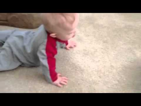 Watch video Down Syndrome Baby crawling for the first time