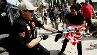 Three people were stabbed, including one who was critically wounded, and 13 were arrested when a Ku Klux Klan rally in Anaheim erupted in violence Saturday, police said.A small group of people representing the Klan had announced that it would hold a rally at Pearson Park at 1:30 p.m., police said. By 11 a.m., several dozen protesters showed up at the park to confront the Klan.
