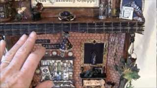 This shadow - cabinet box was made to store the olde curiosity shoppe photo mini album that i made i tutorial on how to make. The base is Tim Holtz Configura...