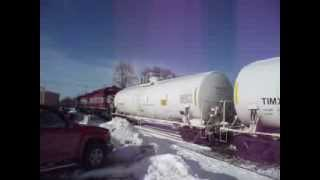 WSOR L355 switching cars behind the Swiss Colony maintenance building on 12/18/13 Pt 2