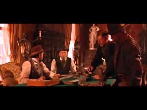 Kurt Russell - Wyatt Earp (Kurt Russell) goes into the saloon and sees that the dealer at the farrow tables a bully, he takes care of it....from Tombstone 1993 Billy Bob Th...