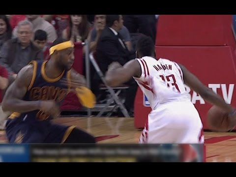 James Harden crosses over LeBron James