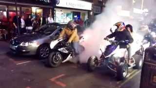 Quad bikes doing burnouts on Brick Lane E1, London