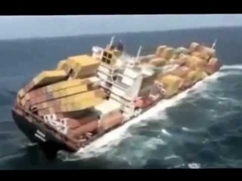 ship runs aground - Mega Container Ship Rena, 236 meters(774 feet) long with a container capacity of 3351 20ft containers, ran aground off the coast of New Zealand.