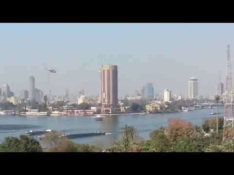 nostrovius - Army helicopters lowering water buckets into the Nile, south of Zamalek island, to help put out fires set by protesters at the Egyptian Football Federation h...