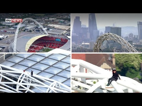 Sky News shows free climber James Kingston scaling Wembley Stadium's iconic arch - the first person ever to do so. Watch the video.