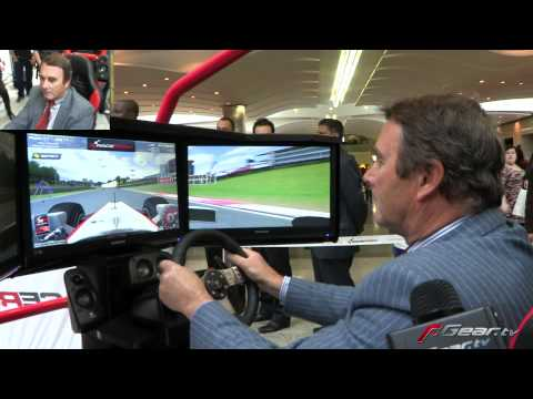 Nigel Mansell playing F1 racing video game