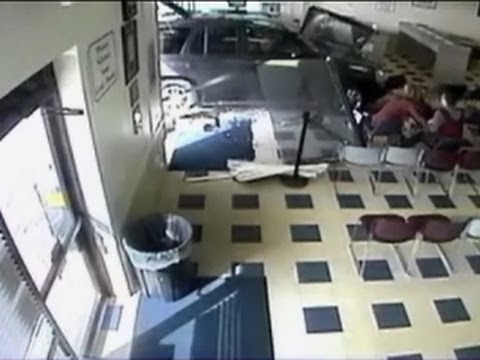 Watch: 10-year-old drives SUV into Colo. DMV building