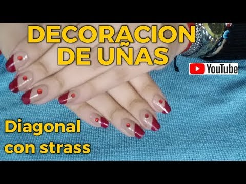 Modelos de uñas - Decoración de Uñas con detalles rojos y piedra strass.