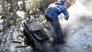 1. Polaris Sportsman 600 twin in the mud