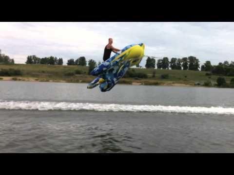 Guy Lifts Off Into the Air Over Water on an Inflatable Kite