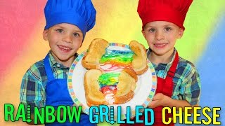 We made super yummy rainbow grilled cheese sandwiches! This is one of the easiest recipes to make with a little kid. It's pretty fun, too! Thanks for watch...
