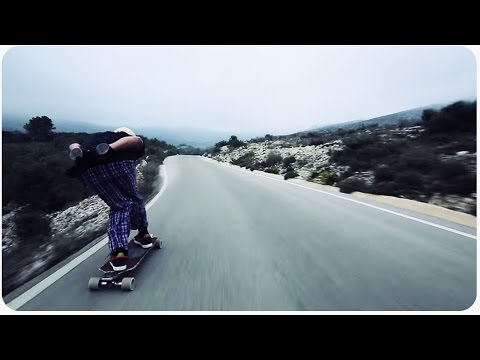 High speed longboard ride down a road with blind curves comes to a sudden end
