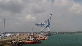Sri Lanka's cabinet cleared a revised agreement for its Chinese-built southern port of Hambantota on Tuesday, the government said, after terms of the first pact ...