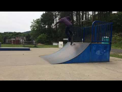 At the Skatepark:  Couple of tricks