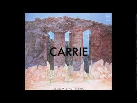 Tekst piosenki Shiny Toy Guns - Carrie po polsku