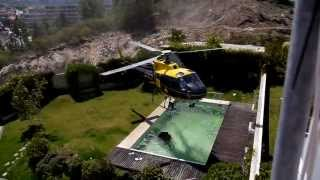 Fire-Helicopter Skillfully takes Water From Swimming Pool
