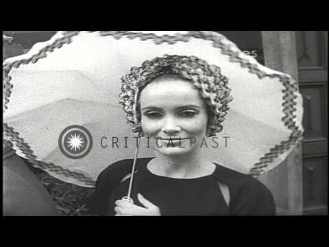 Women display African-inspired designs of Christian Dior hats outside Christian D…HD Stock Footage