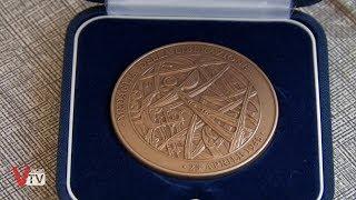 Consegna della medaglia al valore a Romolo Bortolin