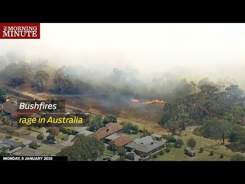 Bushfires destroyed buildings and threatened lives as a heatwave hit three Australian states.