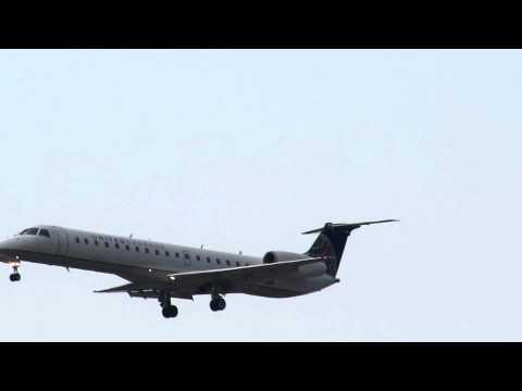 United Express Embraer ERJ-145LR (N14568) lands on Runway 27L at ORD Chicago 07.01.2012