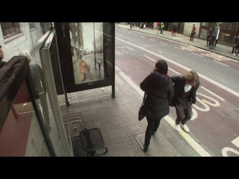 Hilarious bus stop prank: Public see giant robots and alien invasion