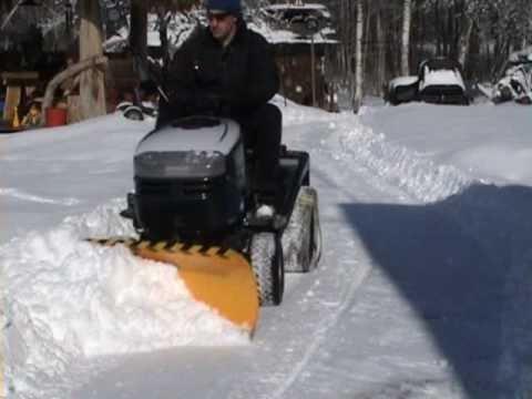 Lawn mower snow plow
