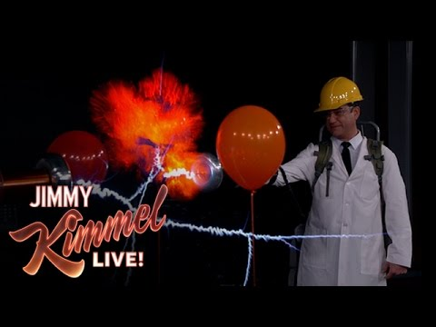 Jimmy Kimmel firing a Tesla gun at hydrogen balloons.