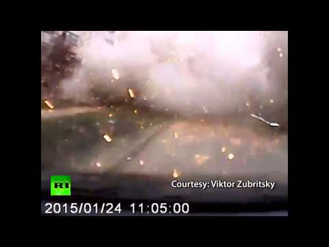footage - Courtesy: Viktor Zubritsky The driver of a car was lucky to survive after filming Saturday's shelling in the southeastern Ukrainian city of Mariupol. At least 30 people were killed and more...