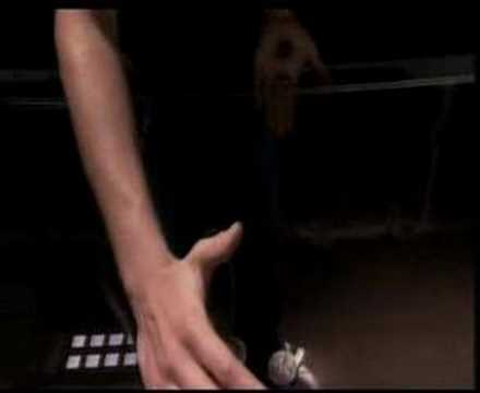 Ali Cook: Amazing coin magic trick. Coins through a glass table