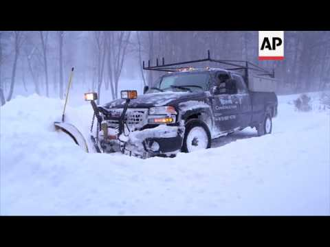 Snow plow operators are hard at work after a howling blizzard heaped snow on most of Massachusetts o