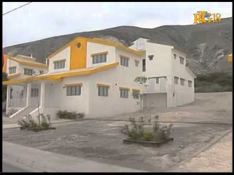 President Martelly participates in the delivery of key housing for police officers
