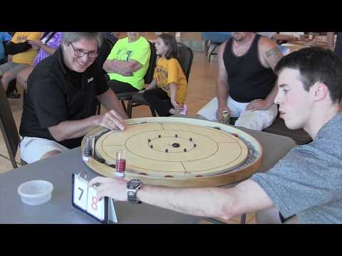 I just found this game called Crokinole, and I've gotta say it's oddly satisfying to watch