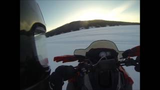 8. Snowmobile Success pond scenic view