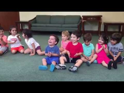 Contagious laughing boy in music class