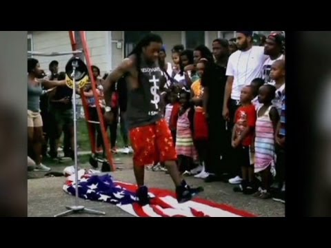 lil - Rapper Lil' Wayne was filmed stepping on an American flag while shooting a video for his song
