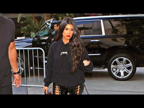 Kourtney Rocks Skintight Lace-Up PVC Pants And YEEZY Gear At Lakers Game