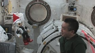 Robot astronaut and human astronaut meet in space
