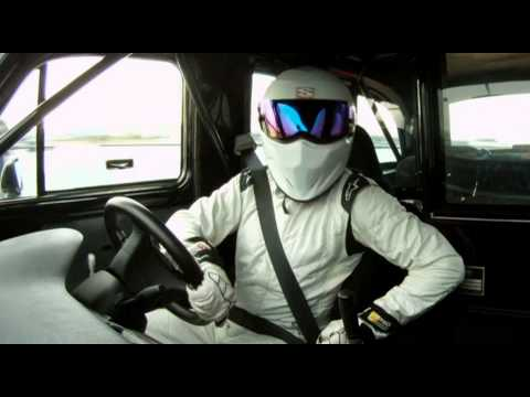 Top Gear Stig - The Stig takes a somewhat terrified Dan Trent for a ride in his special London taxi around the ExCeL centre in London, host for the 2011 Top Gear Live shows.