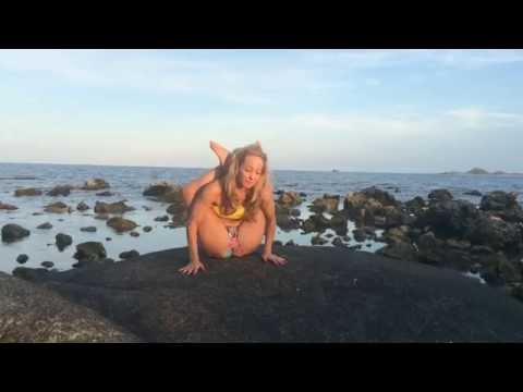 Yoga in Koh Samui: Leg Behind the Head on the Rocks with Kino