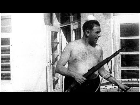 """Camp Commandant Amon Goeth, infamous from the movie """"Schindler's List"""", standing on his balcony p..."""