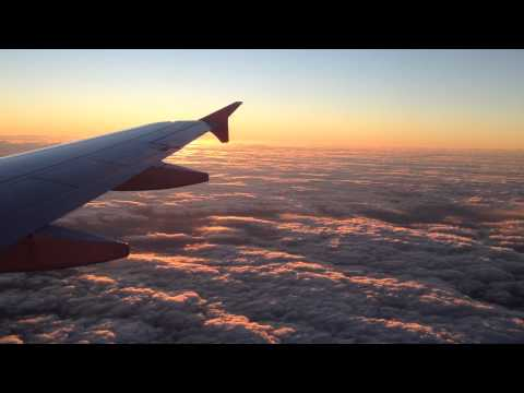 amazing sky view with clouds and twilight from the airplane (HD)
