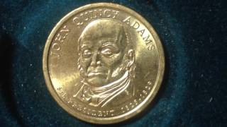 Commemorative issuePresidential dollar coin programObverseJohn Quincy Adams, 6th President of the United States from 1825 to 1829 (son of 2nd U.S. President John Adams)Lettering: JOHN QUINCY ADAMSDE6th PRESIDENT 1825-1829ReverseStatue of LibertyLettering: UNITED STATES OF AMERICA$1DEEngraver: D. EverhartEdgeEngraved with date and both mottos Positions A and B on Presidential and Sacagawea Dollars... The major grading services recognize the up or down orientation of the edge lettering on Presidential Dollars and Sacagawea Dollars, as follows: POSITION A - Edge lettering reads upside-down when the President's portrait faces up POSITION B - Edge lettering reads normally when the President's portrait faces up