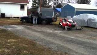 10. Snowmobile pulling out the yota