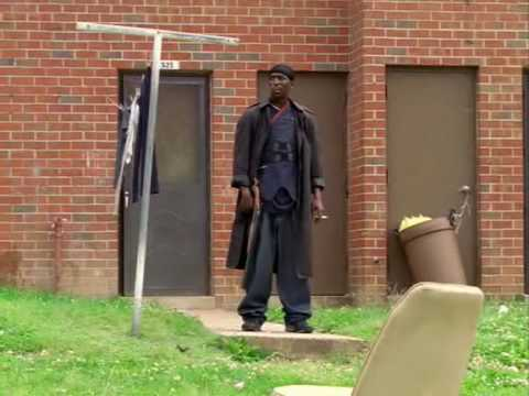 Wire - From Season 1, Episode 9 of The Wire. Omar with his trademark shotgun, goes to the pit and huffs and puffs and calls out Tyrell, who pretends to have a Mac-1...